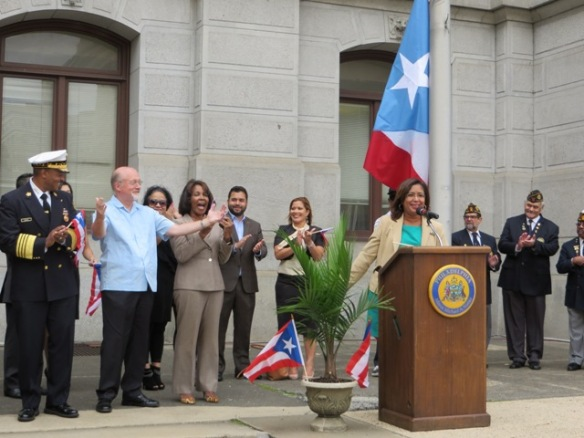 City Councilman William Greenlee (l.) proudly shows off his guayabera, a shirt traditionally warn in the Caribbean -- to the cheers of the crowd and City Councilwoman Blondell Reynolds Brown, MOIMA Deputy Director Fernando Treviño-Martinez, Congreso's Joanna Otero-Cruz and City Councilwoman Maria Quiñones-Sánchez.