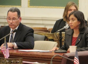 Capt. Francis Healy (l.) and PCHR Executive Director Rue Landau (r.) testify at a committee meeting Tuesday on a proposed hate crimes bill offered by City Council.