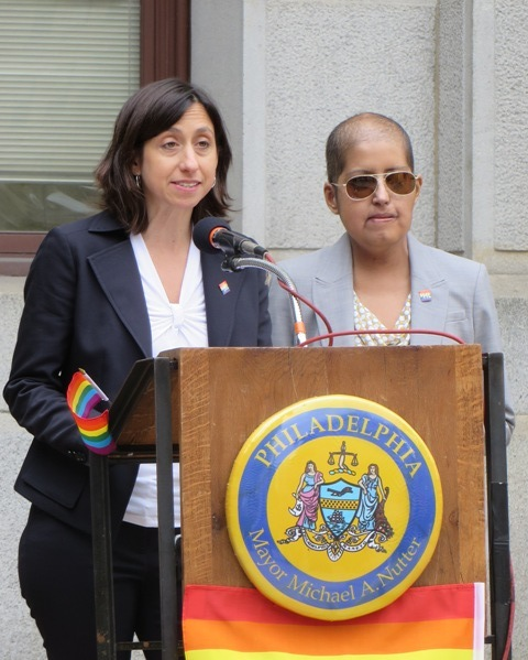 (l-r) PCHR Executive Director Rue Landau and LGBT Affairs Director Gloria Casarez open LGBT History Month at City Hall.