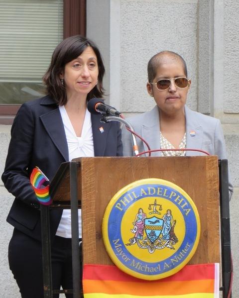 (l-r) PCHR Executive Director Rue Landau and LGBT Affairs Director Gloria Casarez open LGBT History Month at City Hall.