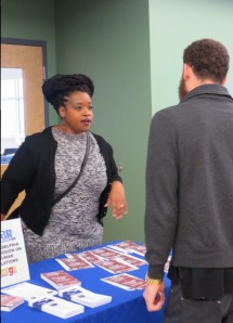 "PCHR's Naarah Crawley answers questions about the city's ""Ban the Box"" law at La Mega 1310 AM's first job fair, held at Esperanza College."
