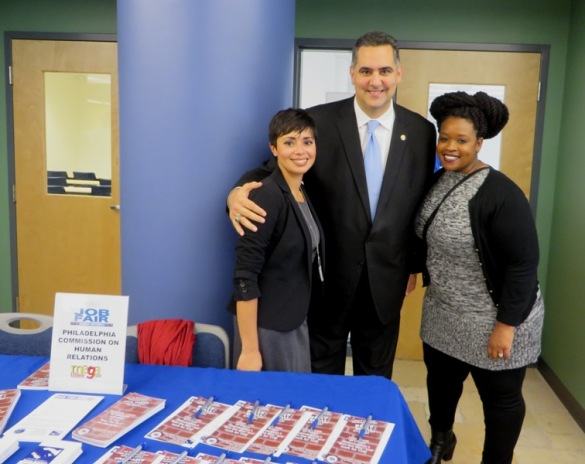 PCHR's Monica Gonzalez and Naarah Crawley get encouragement and thanks from Managing Director Rich Negrin at La Mega's first job fair, held at Esperanza College