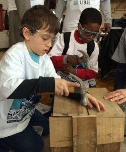 Eli Landau and Eli and Uthman Jabbar Garner work side-by-side on a service project at Girard College, building a flower box for an area school.