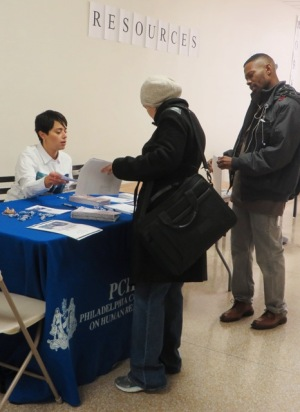 Monica Gonzalez informs job seekers how PCHR defends against discrimination in employment, housing and public accommodation during the Greater Philadelphia Martin Luther King Day of Service at Girard College.