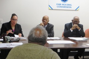 (l-r) Attorney Jennifer Santiago, the newest member of the Philadelphia Fair Housing Commission, joins Commissioners Anthony Lewis Jr.  and the Rev. James S. Allen in reviewing a case with a landlord at a recent hearing.