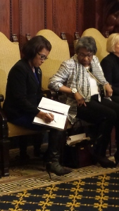 City Councilwoman Blondell Reynolds Brown makes a last-minute edit to her prepared comments during a Women's History Month program at City Hall.