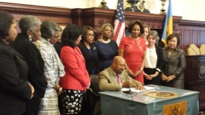 Mayor Nutter signs a bill asking voters to create a  permanent Philadelphia Commission for Women.