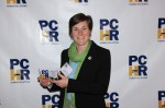 Kristin Gavin shows off the 2015 PCHR Community Excellence Award received by Gearing Up, a citywide nonprofit focused on developing esteem and skills among women in transition.
