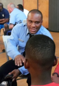 Officer Lamar Wilkerson exchanges ideas with a youthful player at the Wright Rec Center.