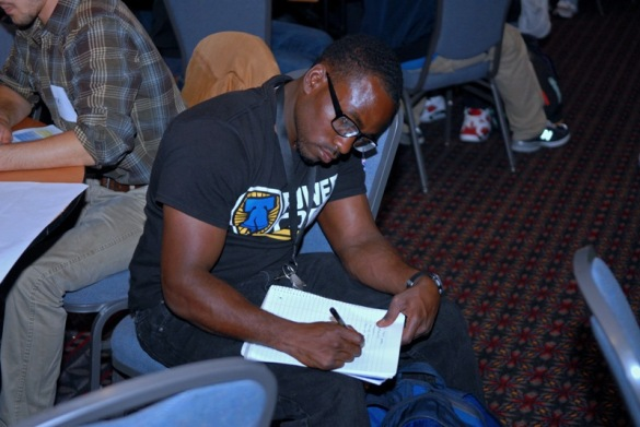 One attendee captures his reflections on paper.