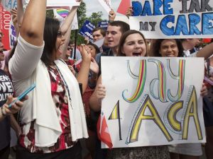Advocates cheer U.S. Supreme Court ruling to uphold the Affordable Care Act. Photo credit: Jacquelyn Martin, AP