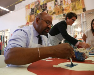 Mayor Nutter was among hundreds of the admirers of Gloria Casarez helping to create her tribute mural.