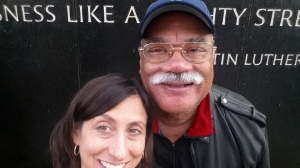 PCHR Executive Director Rue Landau poses at the Civil Rights Memorial Center with Julius Erven McSwain, her bus mate and a veteran investigator for the City of Omaha's Human Rights and Relations Department.