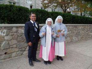 "Deputy Director Randy Duque caught a rare sighting of members of the Holy Spirit Adoration Sisters, from Fairmount's Chapel of Divine Love, Nicknamed the ""Pink Sisters,"" this cloistered order mostly remains indoors in deep contemplation.  The papal visit served as a cherry atop their 100th anniversary celebration."